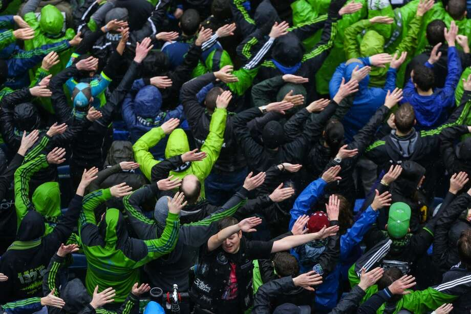 Seattle Sounders fans rally for their team during the Sounders season opener on Saturday, March 8, 2014 at CenturyLink Field. The Sounders defeated Kansas City 1-0. (Joshua Trujillo, seattlepi.com) Photo: SEATTLEPI.COM