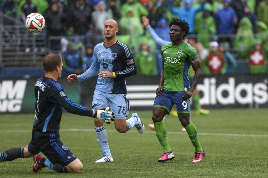Seattle Sounders player Obafemi Martins (9) kicks the ball into the goal but an offsides call is made during the Sounders season opener on Saturday, March 8, 2014 at CenturyLink Field. The Sounders defeated Kansas City 1-0. (Joshua Trujillo, seattlepi.com) Photo: SEATTLEPI.COM