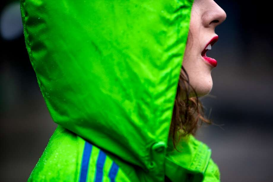"Bright red lipstick stands out from a green-clad Sounders FC band member during the ""March to Match"" before the season home opener against Sporting KC Saturday, March 8, 2014, in Seattle. (Jordan Stead, seattlepi.com) Photo: SEATTLEPI.COM"