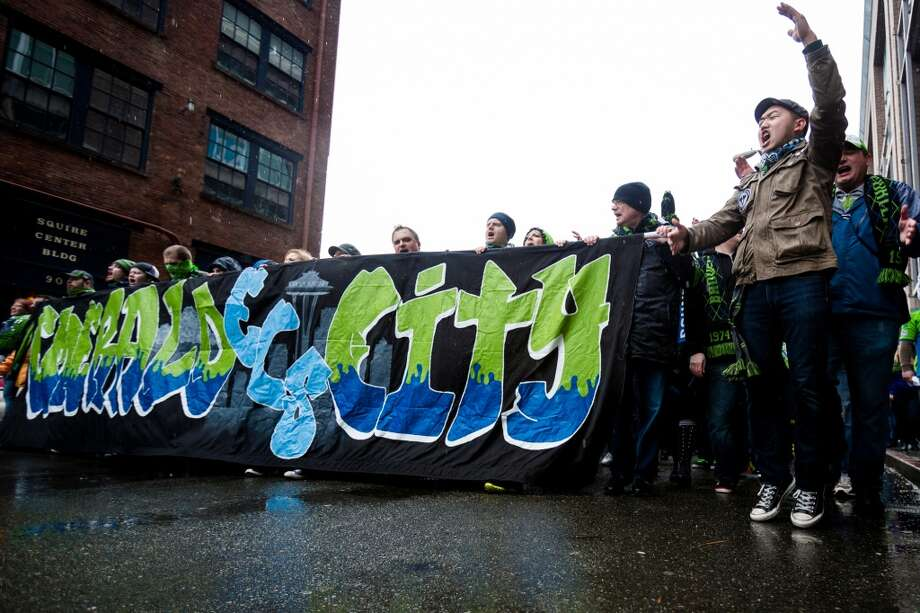 "Sounders FC fans pack the streets from Occidental Park to CenturyLink Field for the ""March to Match"" before the season home opener against Sporting KC Saturday, March 8, 2014, in Seattle. (Jordan Stead, seattlepi.com) Photo: SEATTLEPI.COM"