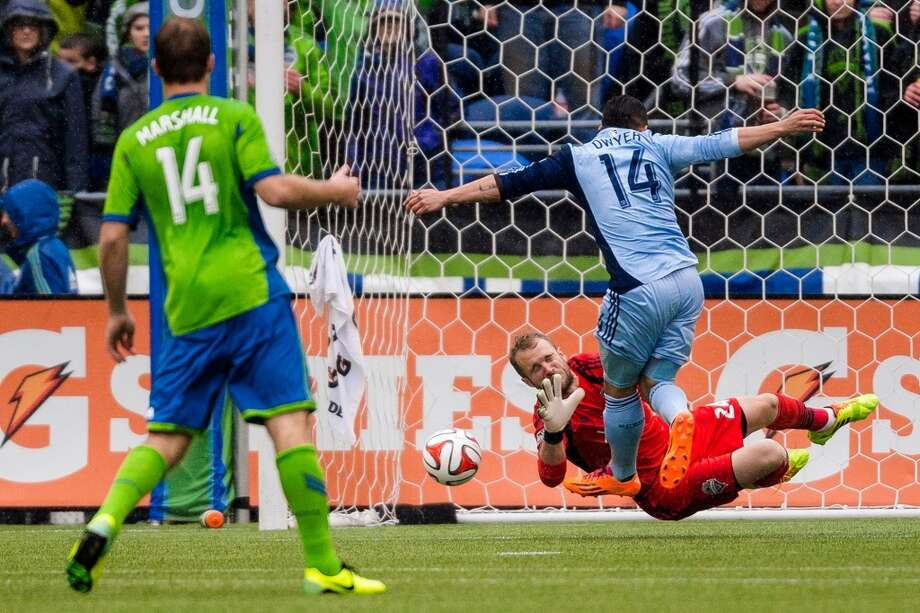 Sounders FC goalkeeper Stefan Frei throws himself in front of a shot during the season home opener against Sporting KC Saturday, March 8, 2014, at CenturyLink Field in Seattle. The Sounders beat Sporting KC 1-0 in the final moments of stoppage time. (Jordan Stead, seattlepi.com) Photo: SEATTLEPI.COM
