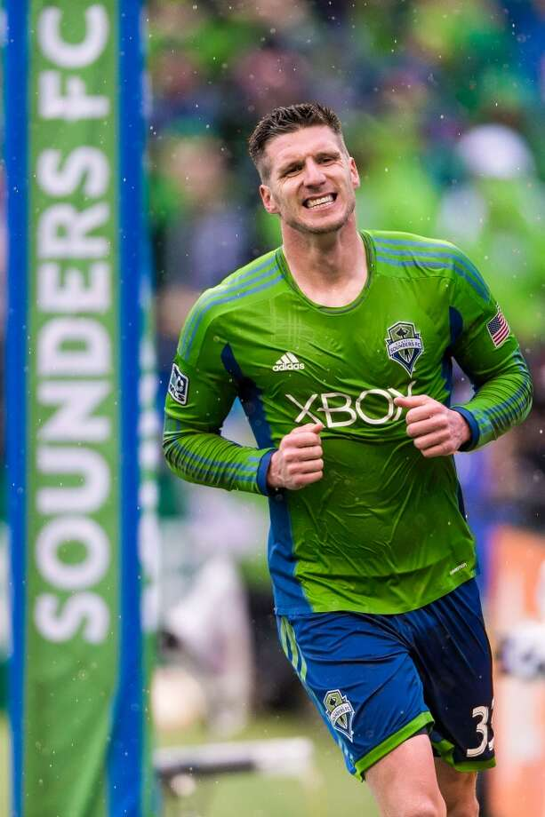 Sounders FC forward Kenny Cooper grimaces after a missed shot on Sporting KC goal during the season home opener Saturday, March 8, 2014, at CenturyLink Field in Seattle. The Sounders beat Sporting KC 1-0 in the final moments of stoppage time. (Jordan Stead, seattlepi.com) Photo: SEATTLEPI.COM