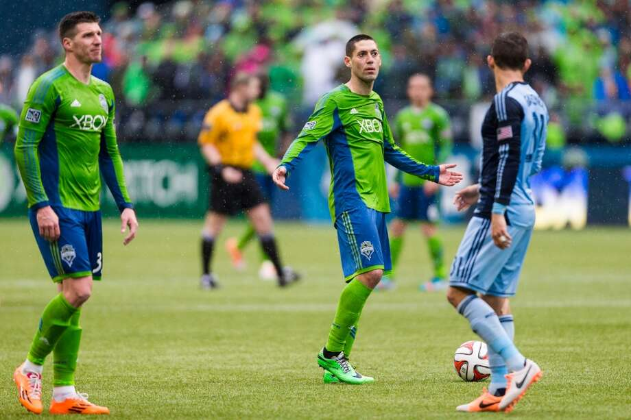 Sounders FC player Clint Dempsey, center right, reacts to a call by a referee during the season home opener against Sporting KC Saturday, March 8, 2014, at CenturyLink Field in Seattle. The Sounders beat Sporting KC 1-0 in the final moments of stoppage time. (Jordan Stead, seattlepi.com) Photo: SEATTLEPI.COM