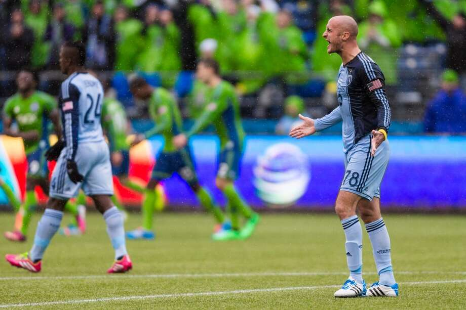 Sporting KC defender Aurelien Collin, right, screams in defeat after losing to the Sounders FC in the final moments of stoppage time during the season home opener Saturday, March 8, 2014, at CenturyLink Field in Seattle. (Jordan Stead, seattlepi.com) Photo: SEATTLEPI.COM
