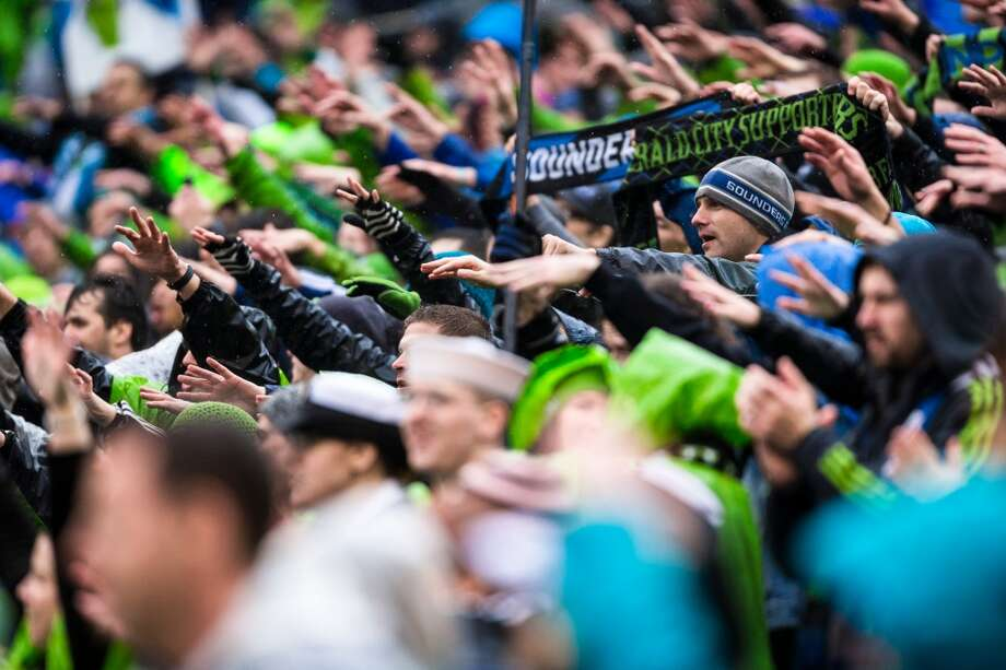 Fans rejoice following a Sounders FC win following the season home opener against Sporting KC Saturday, March 8, 2014, at CenturyLink Field in Seattle. The Sounders beat Sporting KC 1-0 in the final moments of stoppage time. (Jordan Stead, seattlepi.com) Photo: SEATTLEPI.COM
