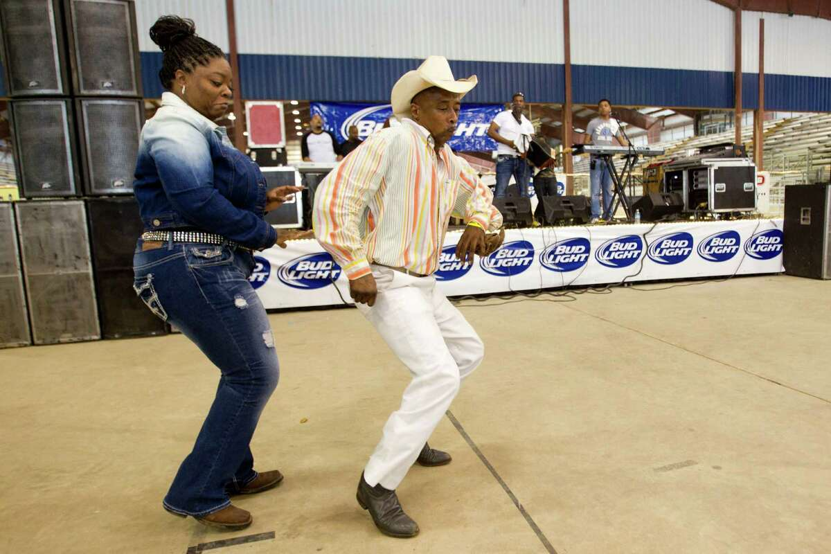 Janice Johnson and Roy Dramgo dance to the music of Lil' Nate & the Zydeco BigTimers at the Humble Civic Center and Arena Saturday, March 8, 2014.