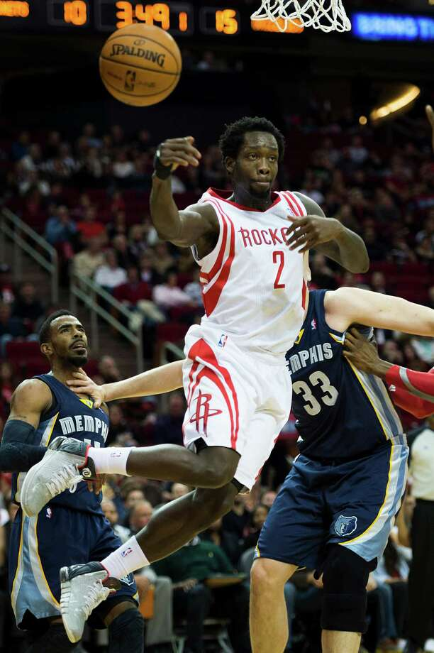 """Pat Beverley, left, has exhibited a gritty, tough-minded style of play that reminds Rockets fans of Mario Elie, right, who is fine with the comparison. """"Guys like us, we feel like we have something to prove,"""" Elie said. Photo: Smiley N. Pool, Staff / © 2014  Houston Chronicle"""