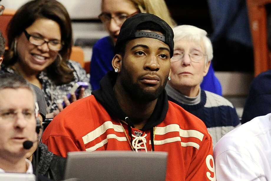 Detroit Piston's center and UConn alumni Andre Drummond watches the second half of an NCAA college basketball game between UConn and Cincinnati in the quarterfinals of the American Athletic Conference women's basketball tournament, Saturday, March 8, 2014, in Uncasville, Conn. Connecticut won 72-42. (AP Photo/Jessica Hill) Photo: Jessica Hill, Associated Press / Associated Press
