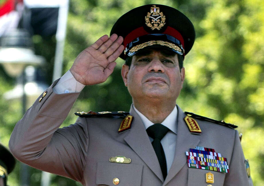 Gen. Abdel-Fattah el-Sissi, considered the popular favorite, would be the fifth Egyptian president to come from the military if he announces his candidacy. He will have a host of problems to confront, including labor disputes and food shortages. Photo: Jim Watson, POOL / POOL AFP