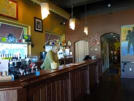 Vino di Amore's downtown Cloverdale tasting room features art displays and live music on Fridays.