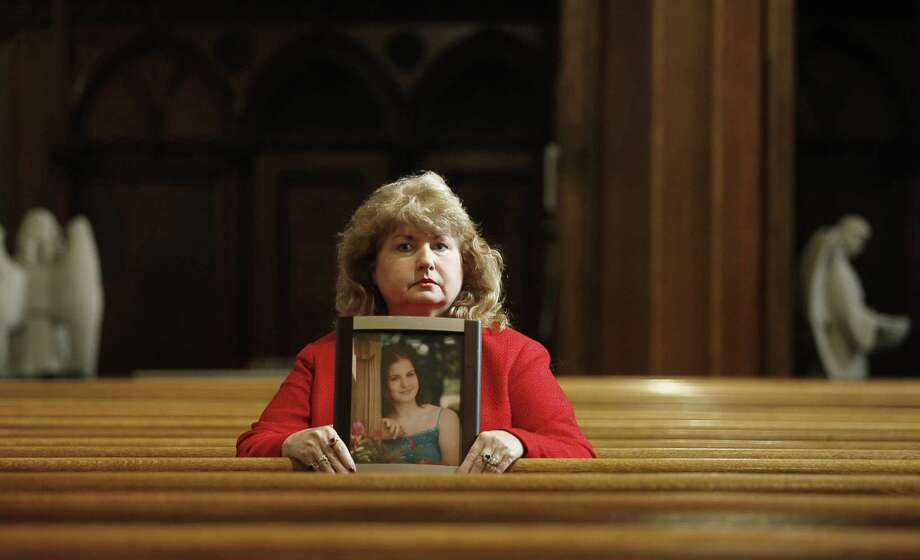 At a church in Scranton, Pa., Mary Ruddy holds a photo of her daughter Kelly Ruddy, 21, who was killed while driving a 2005 Chevrolet Cobalt in 2010. The National Highway Traffic Safety Administration's database contains at least four complaints from Ruddy. Photo: Niko J. Kallianiotis / New York Times / NYTNS