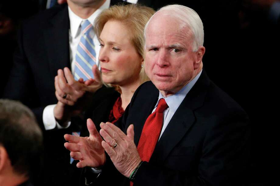 Sen. Kirsten Gillibrand, D-N.Y., and Sen. John McCain, R-Ariz. applaud President Barack Obama's State of the Union address in January. Obama has been reaching out to Congress in an effort to improve their relationship. Photo: Charles Dharapak, STF / AP