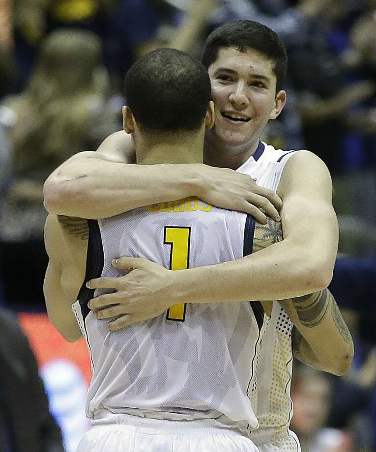 Justin Cobbs (1) hugs Sam Singer at the end of Cal's overtime victory. Photo: Ben Margot, Associated Press