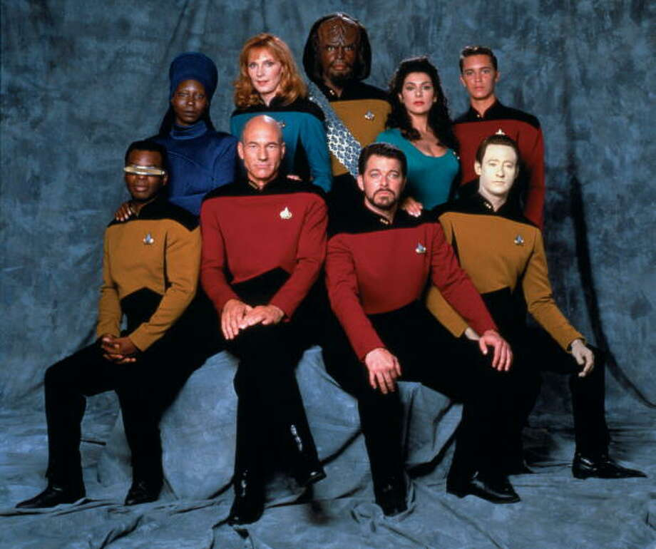 Promotional portrait of the cast of 'Star Trek: The Next Generation,' California, 1987. Pictured are from left, front row, American actor LeVar Burton (as Lieutenant Commander Geordi La Forge), British actor Patrick Stewart (as Captain Jean-Luc Picard), and American actors Jonathan Frakes (as Commander William T. Riker) and Brent Spiner (as Lieutenant Commander Data); from left, back row, American actors Whoopi Goldberg (as Guinan), Gates McFadden (as Doctor Beverly Crusher), and Michael Dorn (as Lieutenant Worf), British-American actress Marina Sirtis (as Counselor Deanna Troi), and American actor Wil Wheaton (as Wesley Crusher). Photo: CBS Photo Archive, Getty Images / 2010 CBS WORLDWIDE INC.