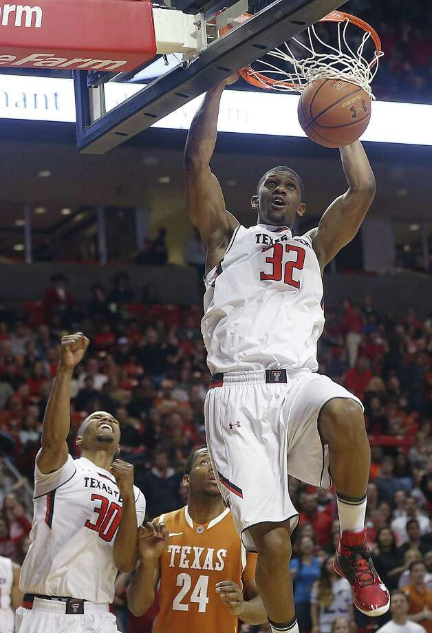 Texas Tech's Jordan Tolbert dunks in front of teammate Jaye Crockett and Texas' Martez Walker (middle). Photo: Zach Long / Lubbock Avalanche-Journal / Lubbock Avalanche-Journal