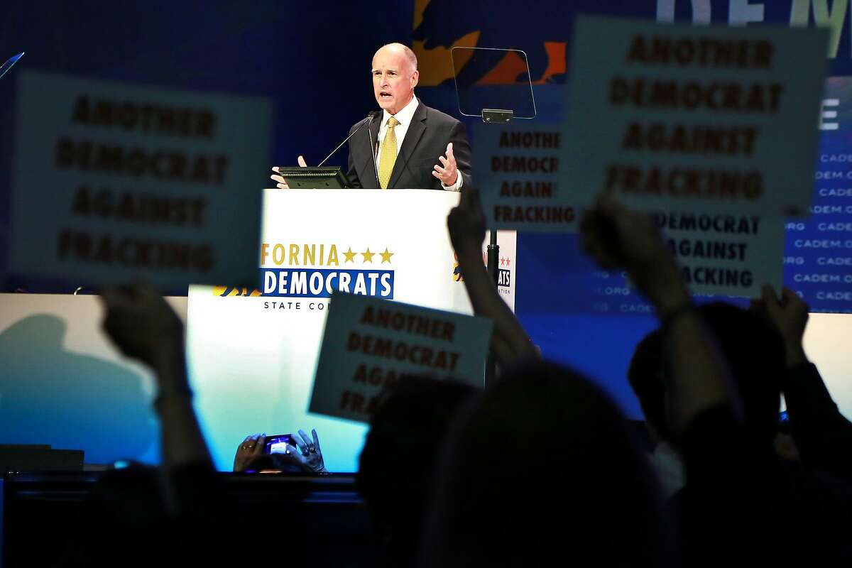 Gov. Jerry Brown addresses the California Democratic Convention as anti fracking protestors demonstrate during his speech in Los Angeles, California March 8, 2014. photo/Jonathan Alcorn for the Chronicle