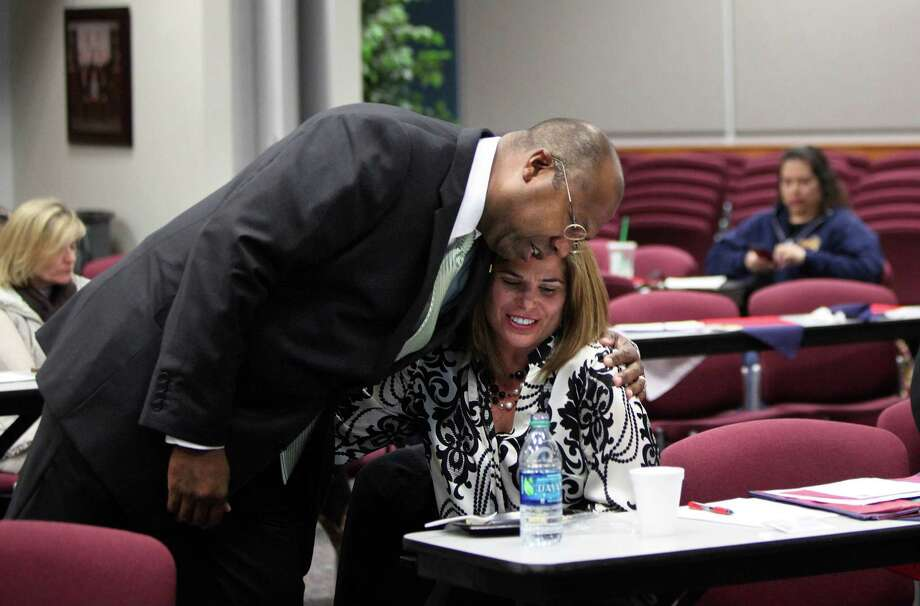 Katy ISD Superintendent Alton Frailey greets Julianna Carr ahead of a roundtable discussion last month with parents from the district. Frailey is hoping parents will champion another bond issue. Photo: Mayra Beltran, Staff / © 2014 Houston Chronicle