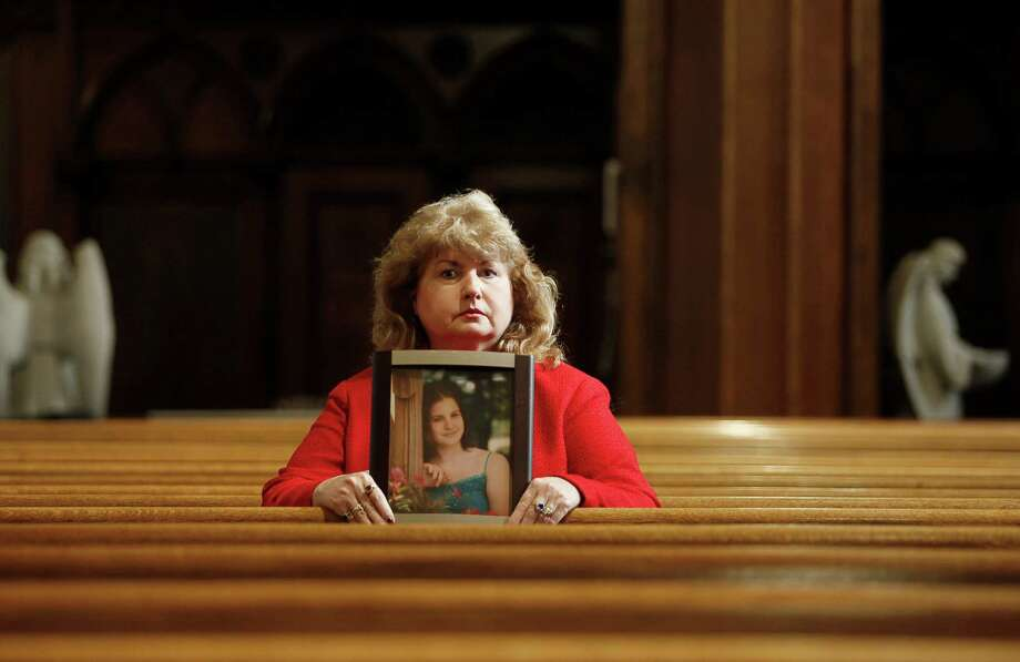Mary Ruddy holds a picture of her daughter Kelly, who was killed while driving a 2005 Chevrolet Cobalt, at the St. Patrick's Rectory in Scranton, Pa., on Friday.  Ruddy filed four complaints with federal regulators. Photo: NIKO J. KALLIANIOTIS, STR / NYTNS