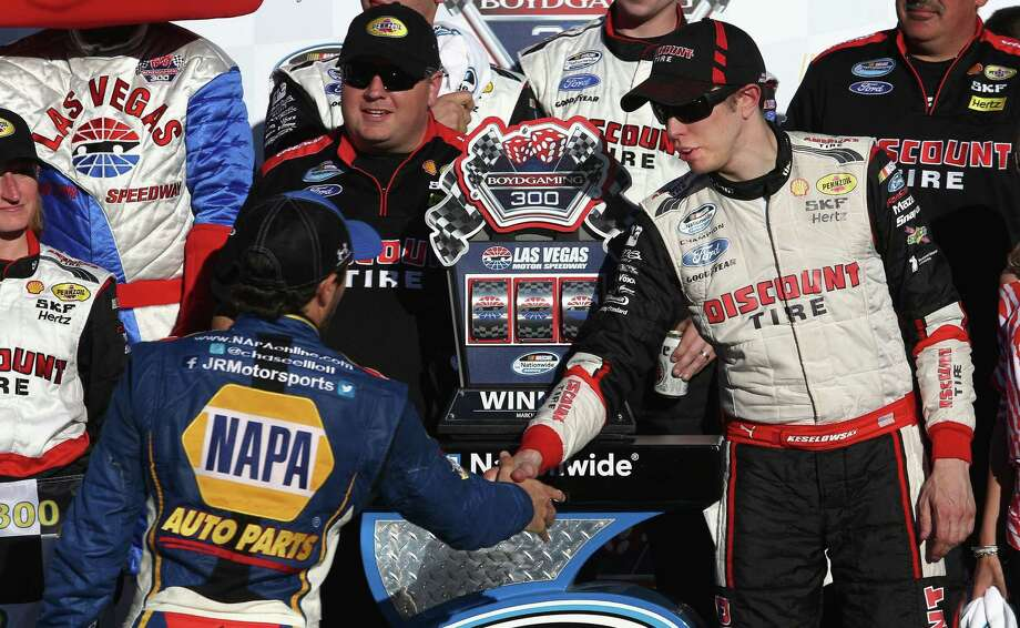 Chase Elliott (left) congratulates Brad Keselowski in Victory Lane after Keselowski won the Nationwide Series Boyd Gaming 300 on Saturday. Photo: Todd Warshaw / Getty Images / 2014 Getty Images