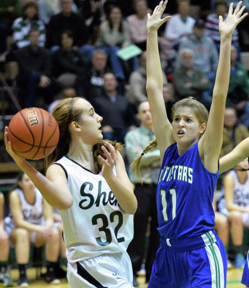 Shen's #32 Carly Boland, left, looks for a way around Cicero-North Syracuse's #11 Emilee Norris during the  Class AA girls' regional final Saturday March 8, 2014, in Troy, NY.  (John Carl D'Annibale / Times Union) Photo: John Carl D'Annibale / 00026034A