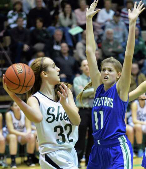 Shen's #32 Carly Boland, left, looks for a way around Cicero-North Syracuse's #11 Emilee Norris duri