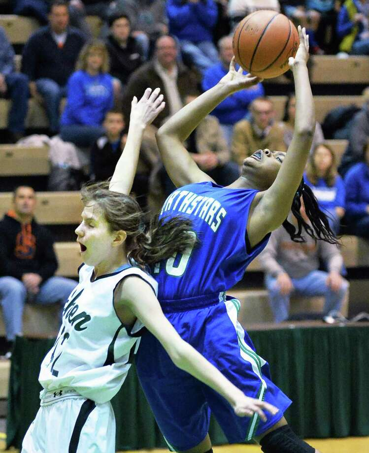 Shen's #42 Alexandra Tudor, left, and Cicero-North Syracuse's #40 Amani Free collide under the basket during the  Class AA girls' regional final Saturday March 8, 2014, in Troy, NY.  (John Carl D'Annibale / Times Union) Photo: John Carl D'Annibale / 00026034A
