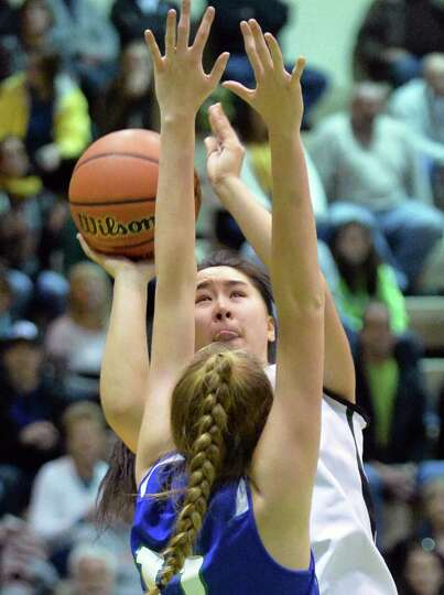Shen's ##31 Amanda Lee shoots during the Class AA girls' regional final against Cicero-North Syracus