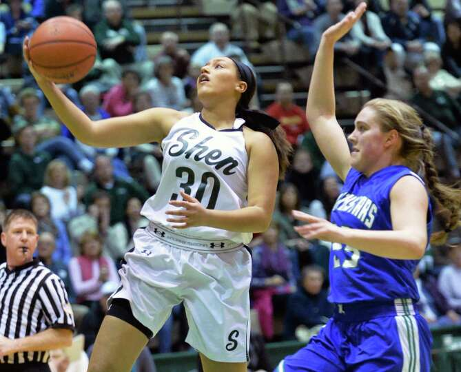 Shen's #30 Samira Sangare, left, and Cicero-North Syracuse's #23 Elizabeth Miles under the basket du