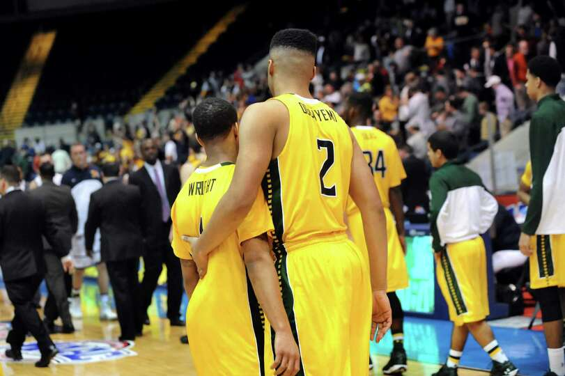 Siena's Marquis Wright, left, and Javion Ogunyemi, center, react to their 71-65 loss to Canisius in
