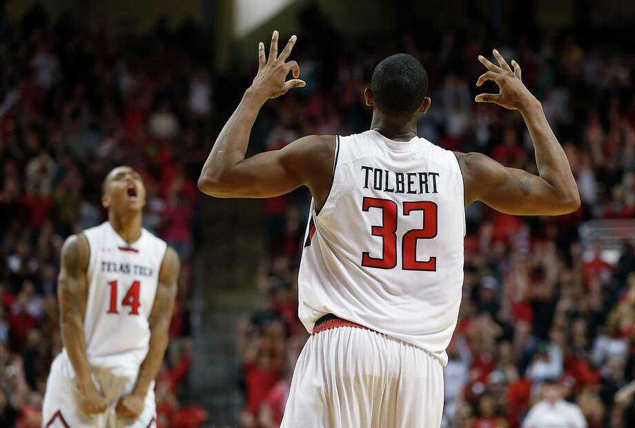 Texas Tech's Jordan Tolbert (32) gets an assist from teammate Robert Turner (14) as they celebrate Tolbert's 3-pointer against Texas on Saturday. Photo: Zach Long, MBI / Lubbock Avalanche-Journal