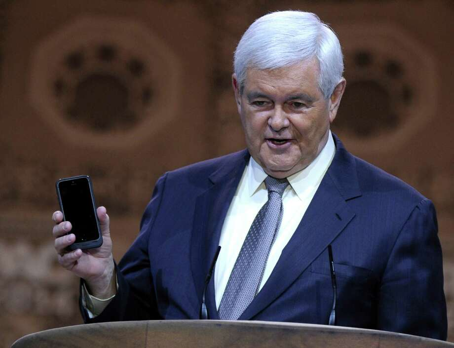 House Speaker Newt Gingrich holds up a smart phone as he speaks at the Conservative Political Action Conference annual meeting in National Harbor, Md., Saturday, March 8, 2014. Saturday marks the third and final day of the annual Conservative Political Action Conference, which brings together prospective presidential candidates, conservative opinion leaders and tea party activists from coast to coast. (AP Photo/Susan Walsh) Photo: Susan Walsh, STF / AP