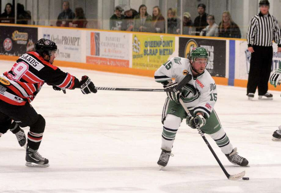 Danbury Whalers james Sanford has possession while  Watertown Privateers Brent Sands tries to steal during a game at Danbury on Saturday, March 8, 2014. Photo: Lisa Weir / The News-Times Freelance