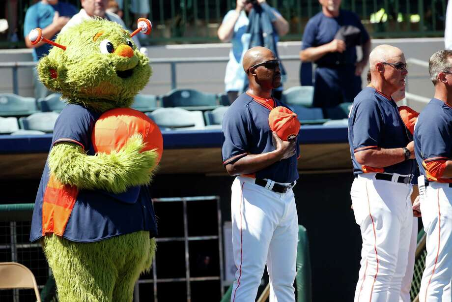 Astros mascot Orbit joins manager Bo Porter for the national anthem before the start of Saturday's exhibition game against the Yankees at Kissimmee, Fla. New York won 9-6. The Astros' split squad also lost to Philadelphia 11-3. Photo: Alex Brandon, STF / AP