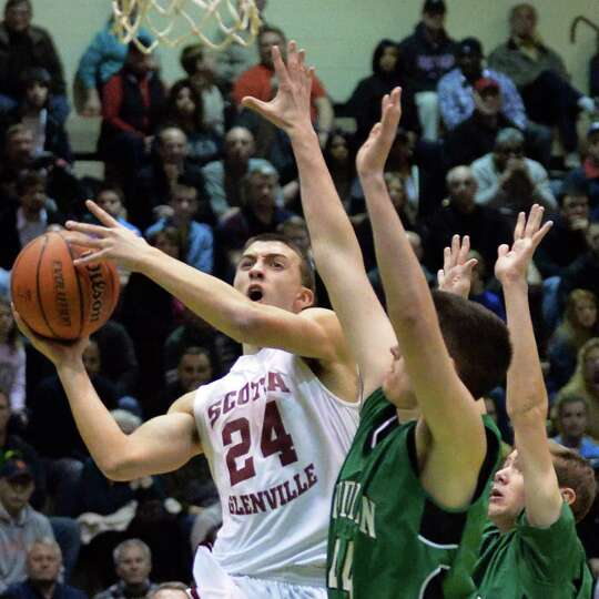 Scotia's #24 Joe Cremo, left, fights off  Bishop Ludden defenders during the Class A boys' regional