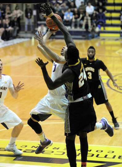 UAlbany's Gary Johnson goes in for a basket during their America East Tournament game against UMBC a