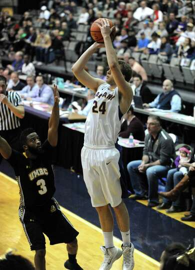 UAlbany's Dallas Ennema shoots a three pointer during their America East Tournament game against
