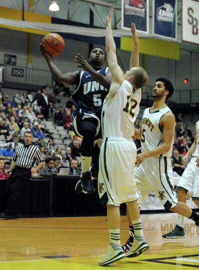 UNH's Jordon Bronner drives to the basket during their America East Tournament game against Vermont