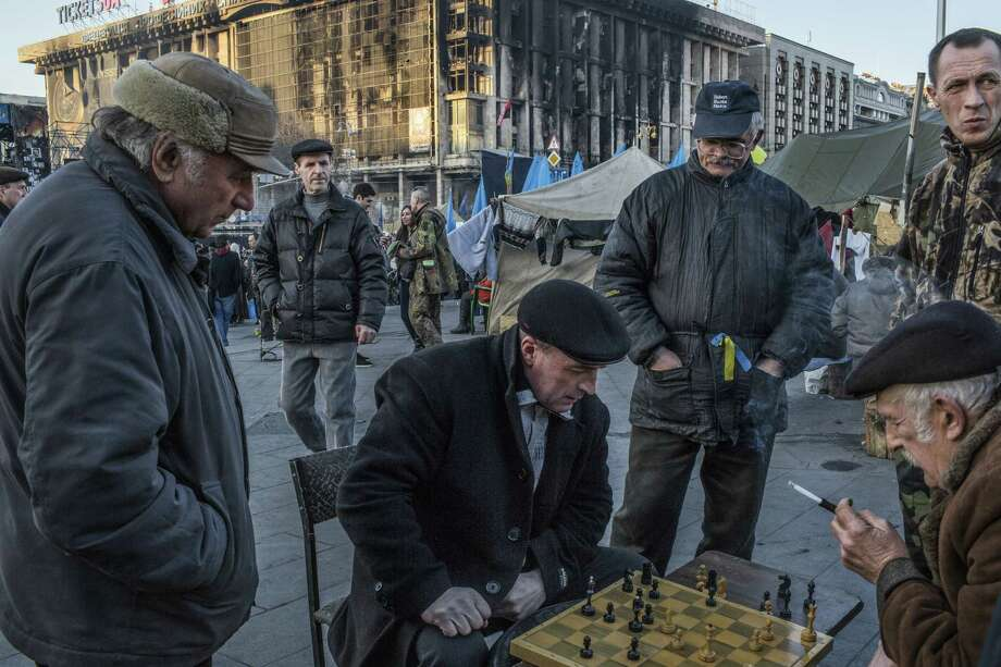 Men play chess amid demonstrators' encampments in Independence Square in Kiev, Ukraine. Meanwhile on Saturday, an unidentified military official told Russian news agencies that Russia was considering suspending inspections of its nuclear arsenal required by the strategic arms-reduction treaties. Photo: Mauricio Lima / New York Times / NYTNS