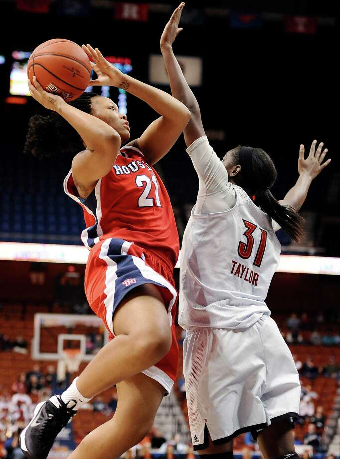 Houston's Jessieka Palmer is fouled by Louisville's Asia Taylor as she scores two of her 13 points in Saturday's loss. Photo: Jessica Hill, FRE / FR125654 AP