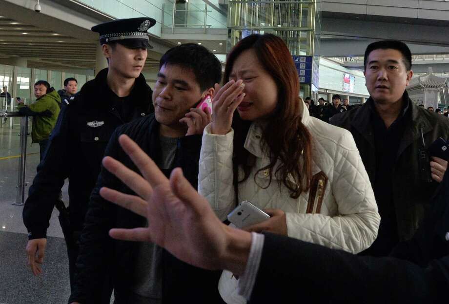 Emotions were high as relatives and loved ones awaited news of the missing Malaysia Airlines Boeing jet, carrying 239 people from Kuala Lumpur to Beijing, at the Beijing Airport. Photo: Mark Ralston / Getty Images / AFP