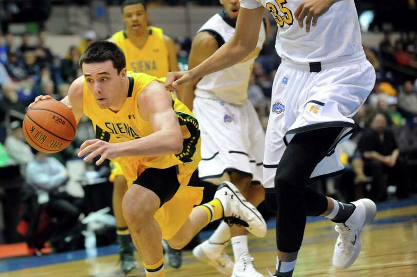 Siena's Brett Bisping, left, pursues the ball in their second-round basketball game of the MAAC Tour