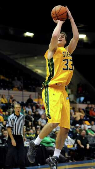 Siena's Rob Poole shoots for three points in their second-round basketball game of the MAAC Tourname