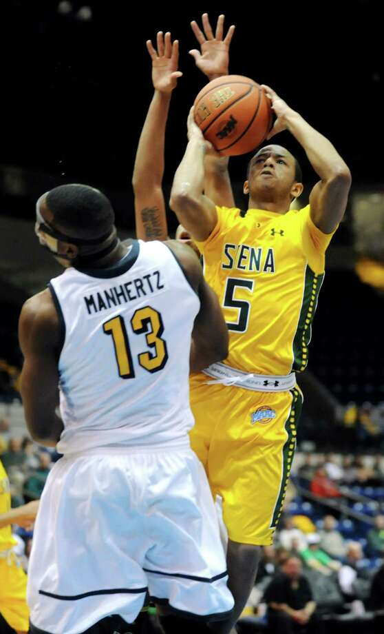Siena's Evan Hymes, right, shoots for the hoop as Canisius' Chris Manhertz defends in their second-round basketball game of the MAAC Tournament on Saturday, March 8, 2014, at MassMutual Center in Springfield, Mass. (Cindy Schultz / Times Union) Photo: Cindy Schultz / 00026001A
