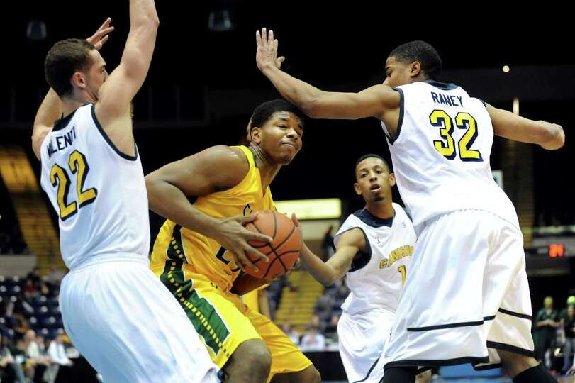 Siena's Lavon Long, center, is blocked in as Canisius' Phil Valenti, left, Zach Lewis, second from r