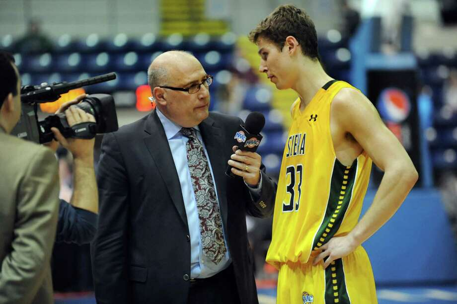 Former Siena coach Mitch Buonaguro, center, interviews Siena's Rob Poole at halftime for ESPN3 during their second-round basketball game of the MAAC Tournament against Canisius on Saturday, March 8, 2014, at MassMutual Center in Springfield, Mass. (Cindy Schultz / Times Union) Photo: Cindy Schultz / 00026001A