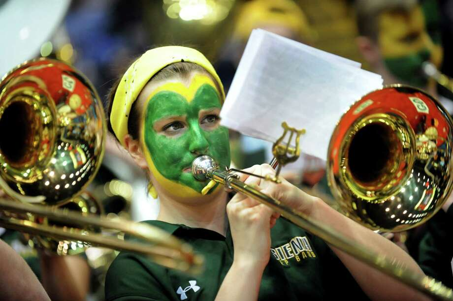 Sarah Green, 19, plays trombone with Siena's pep band during their second-round basketball game of the MAAC Tournament against Canisius on Saturday, March 8, 2014, at MassMutual Center in Springfield, Mass. (Cindy Schultz / Times Union) Photo: Cindy Schultz / 00026001A