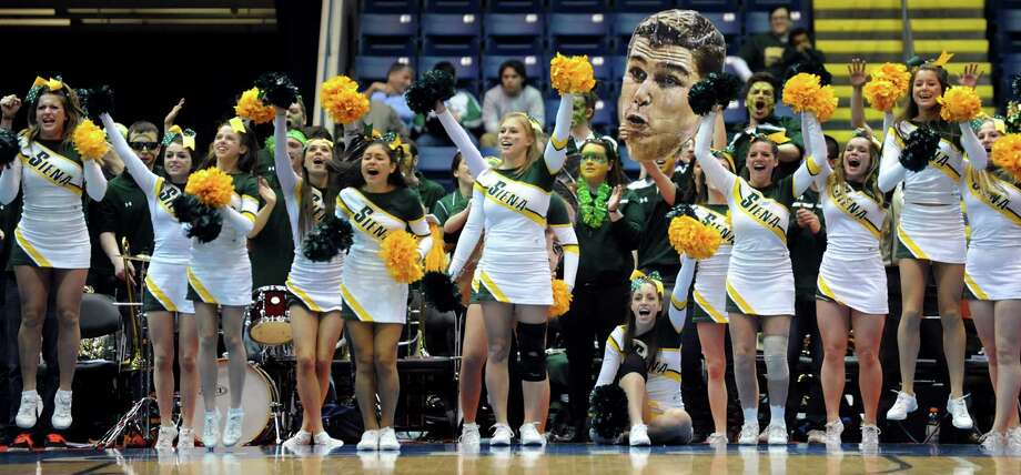 Siena's cheer team and pep band cheer on their team during their second-round basketball game of the MAAC Tournament against Canisius on Saturday, March 8, 2014, at MassMutual Center in Springfield, Mass. (Cindy Schultz / Times Union) Photo: Cindy Schultz / 00026001A