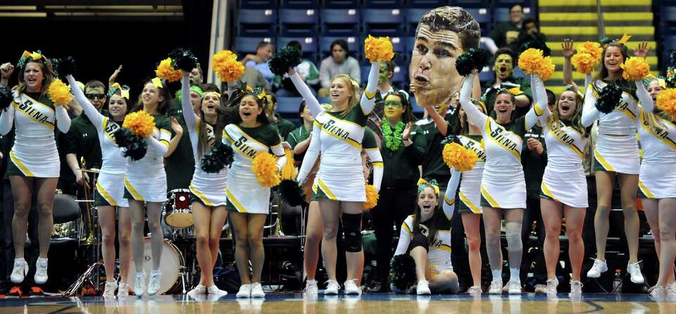 Siena's cheer team and pep band cheer on their team during their second-round basketball game of the