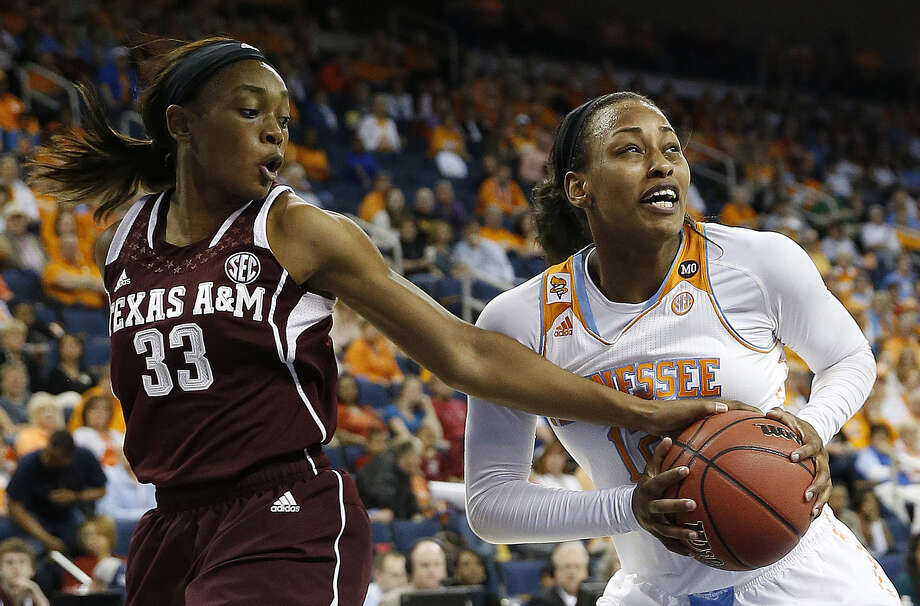 Texas A&M guard Courtney Walker tries to keep Tennessee forward Bashaara Graves from getting to the basket in the first half of the SEC tournament semifinal game in Duluth, Ga. Photo: John Bazemore / Associated Press / AP
