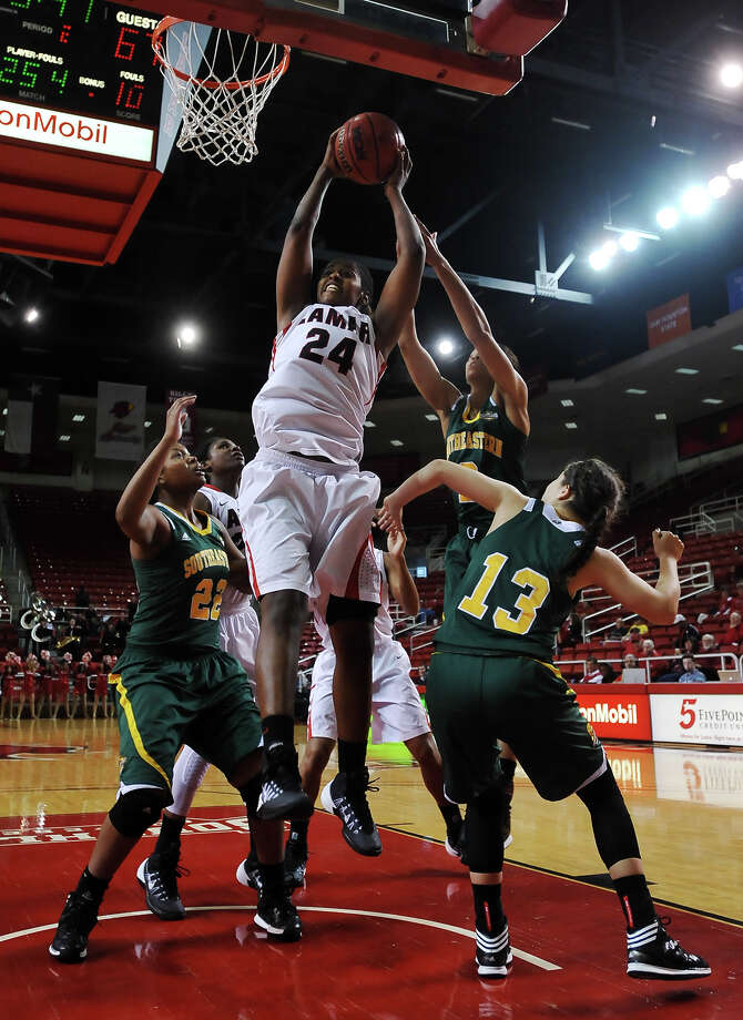 Lamar's Alice Robinson, No. 24, goes up for a rebound during Saturday afternoon's game with Southeastern Louisiana. Lamar University played against Southeastern Louisiana at the Montagne Center on Saturday. Photo taken Saturday, 3/8/14 Jake Daniels/@JakeD_in_SETX Photo: Jake Daniels / ©2014 The Beaumont Enterprise/Jake Daniels